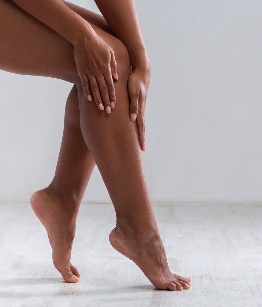Woman touching her smooth legs