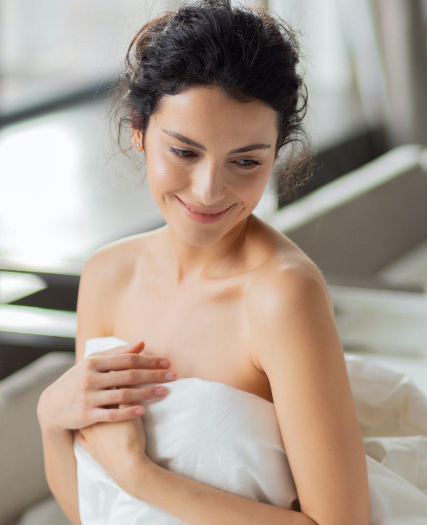Happy woman in a towel
