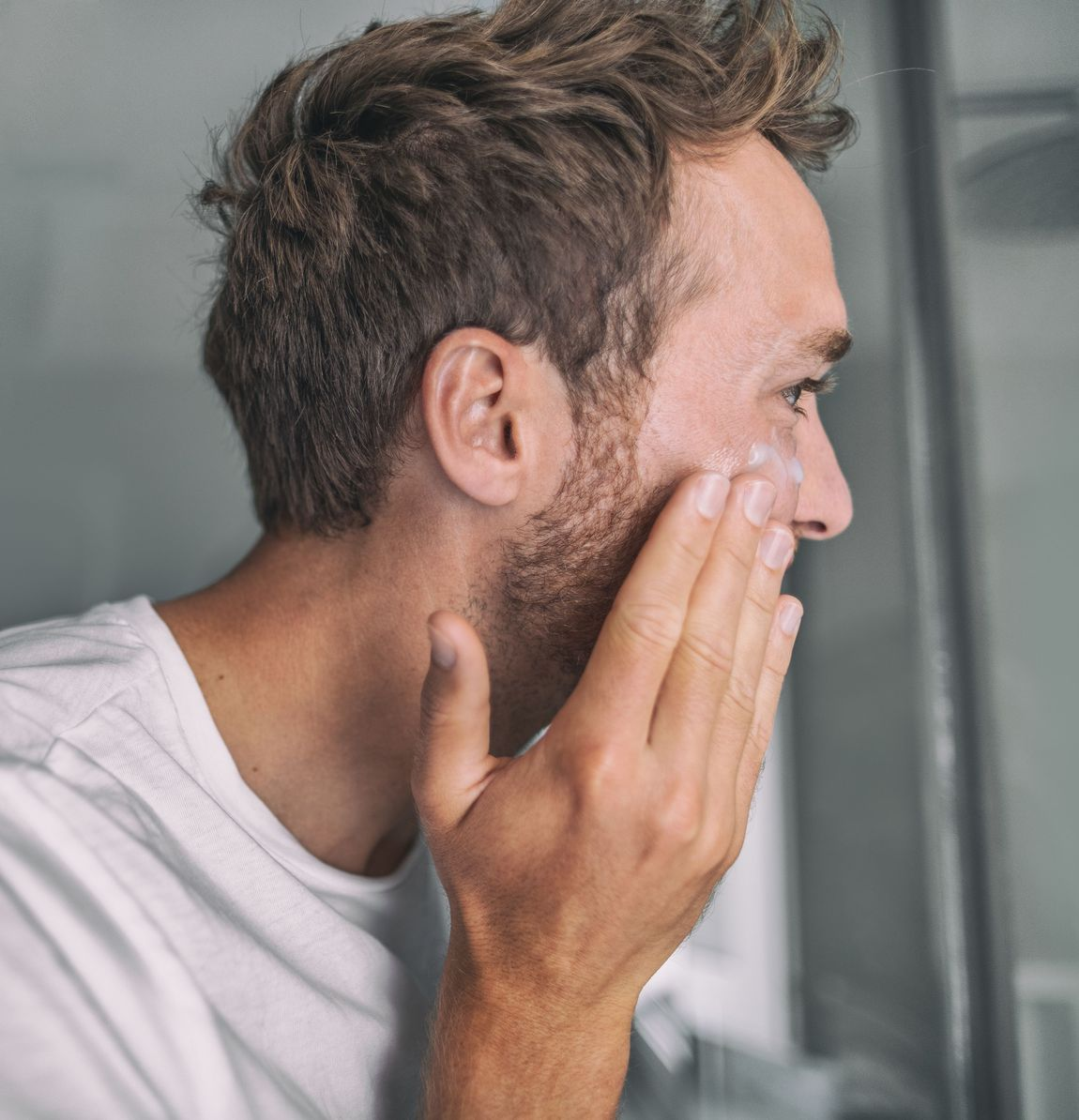Man applying a facial cleanser