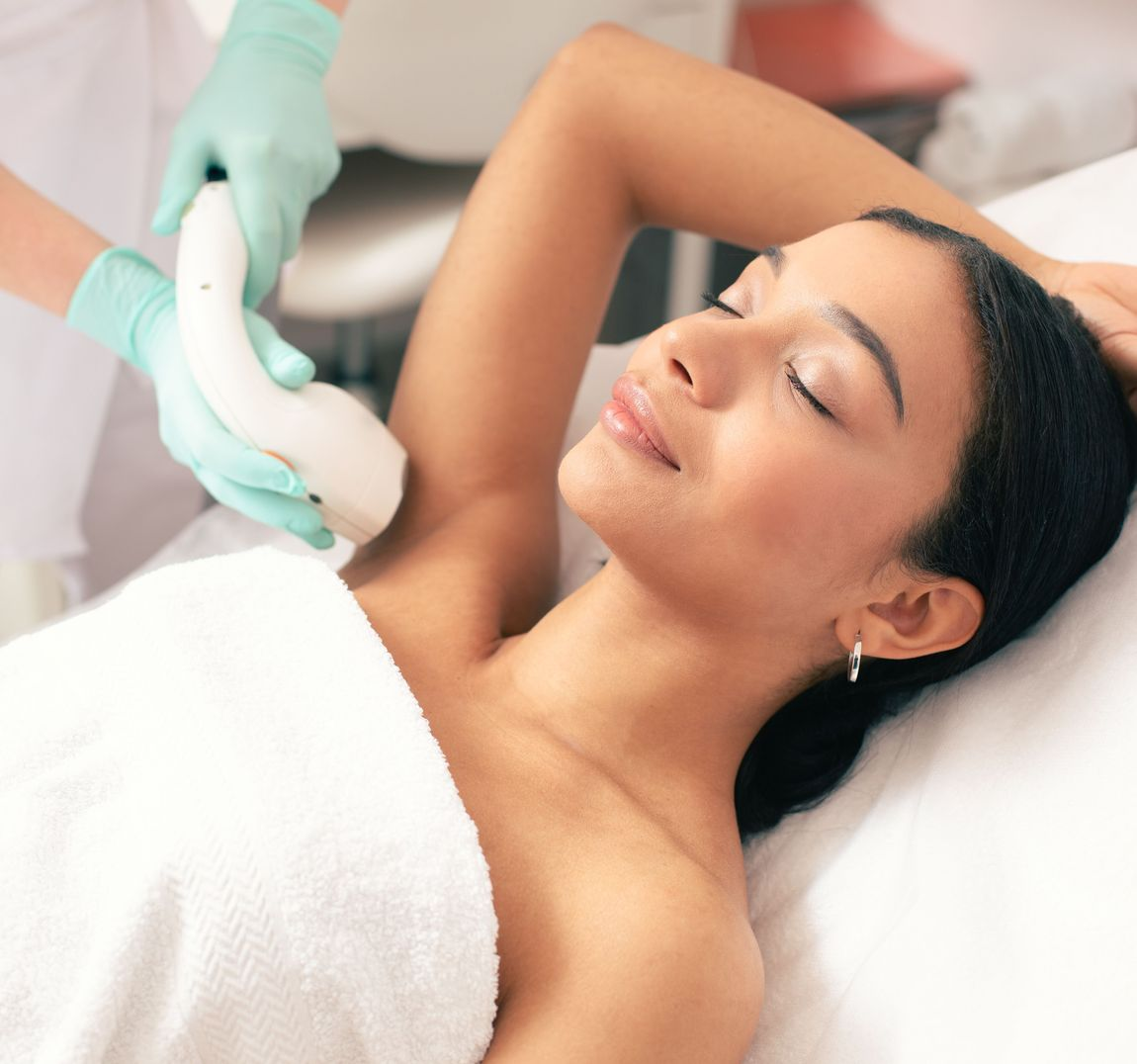 Woman receiving laser hair removal treatments